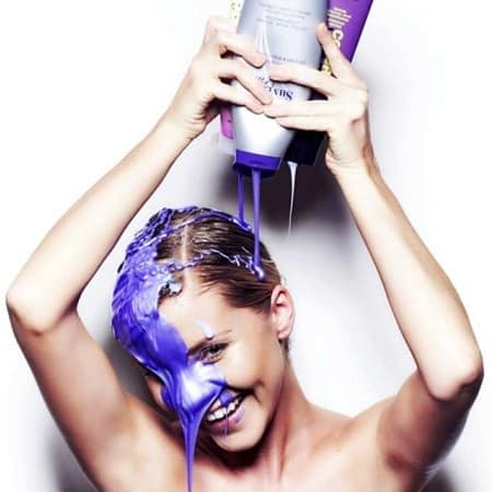 Woman Pouring Purple Shampoo On Head