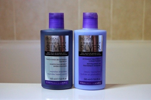Bottles Of Purple Shampoo And Conditioner